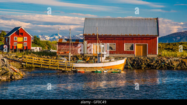 Colorful Fishing Boat and Boat House in Bay, Bud More and Romsdal area. West Coast, Norway, Scandanavia - Stock Image