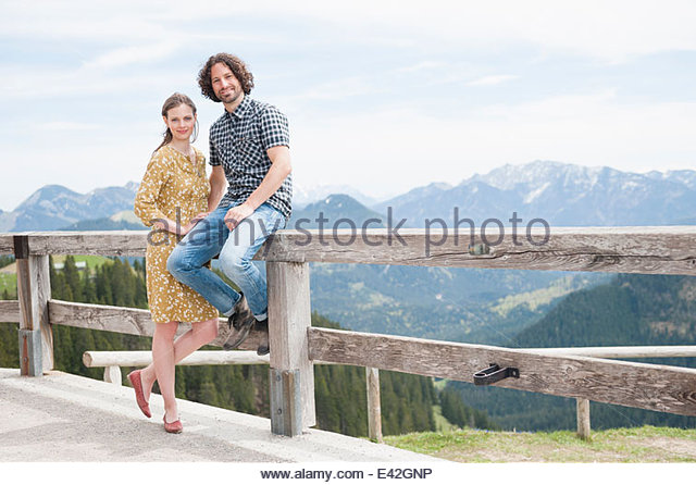 Mid adult couple on viewing platform, Wallberg, Tegernsee, Bavaria, Germany - Stock Image