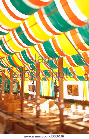Beer tent Oktoberfest Munich defocused empty - Stock Image