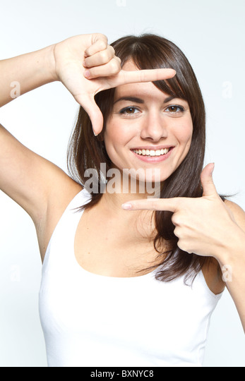 woman with frame sign - Stock Image