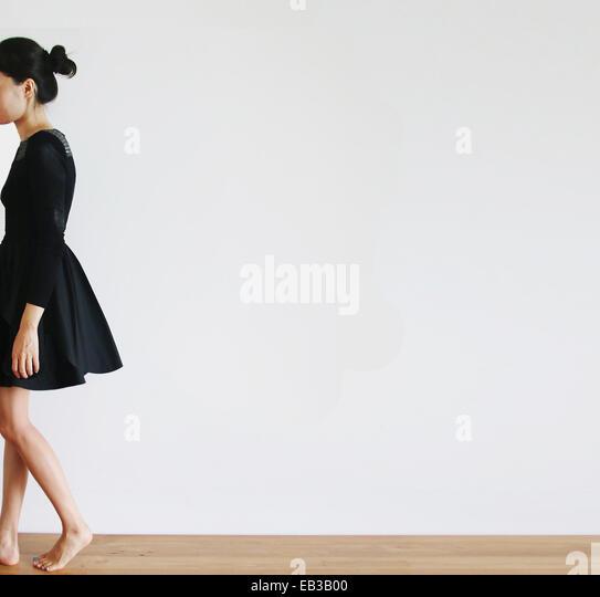 China, Hong Kong, Woman walking away - Stock Image