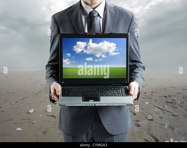 environment concept: Businessman holding his laptop - Stock-Bilder