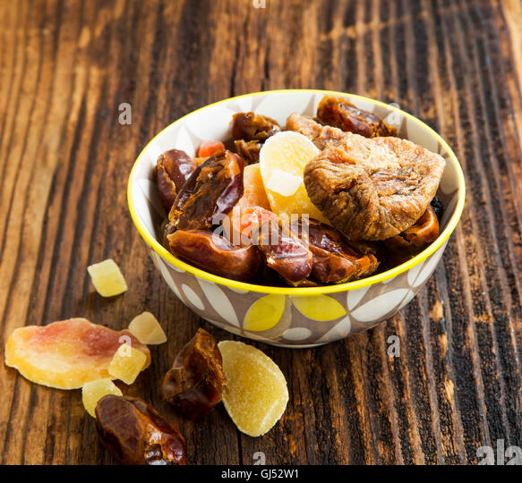 Dried and candied fruits assortment in a bowl - Stock Image