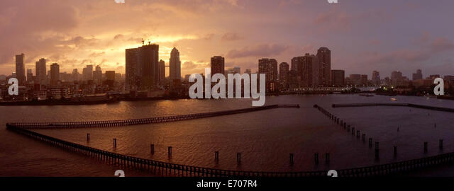 Panorama of the city of Tokyo in a stormy sunset - Stock Image