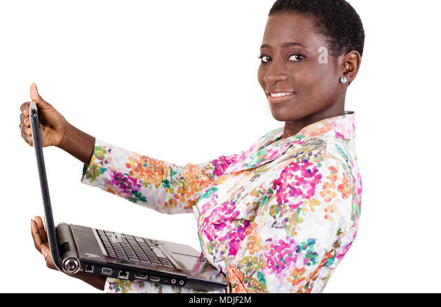 This young businesswoman loves to work with her laptop everywhere as it is very convenient - Stock Image