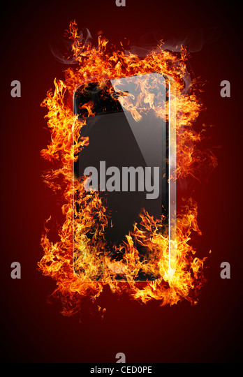 Phone with no labels on fire - Stock Image