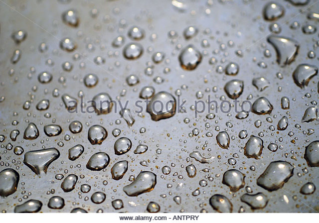Water droplets on metal surface - Stock Image