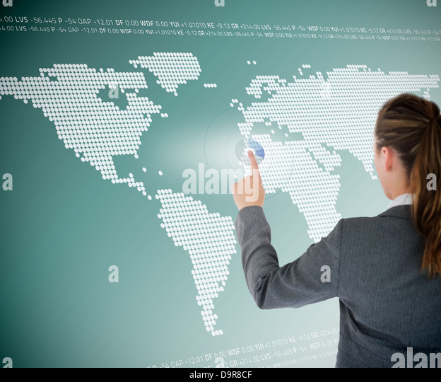 Well dressed business woman using futuristic interface - Stock Image