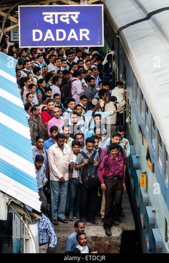 Mumbai India Indian Asian Dadar Central Western Railway Line Station train public transportation riders commuters - Stock Image