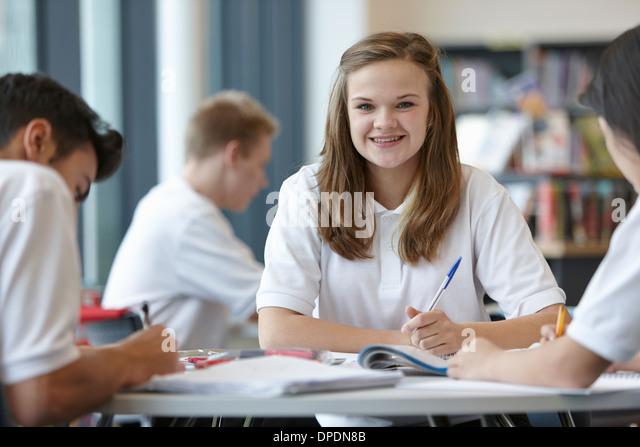 Group of teenagers working in school classroom - Stock-Bilder