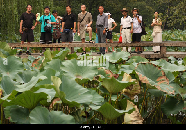 Chinese tour group, Humble Administrator's Garden, Suzhou - Stock Image