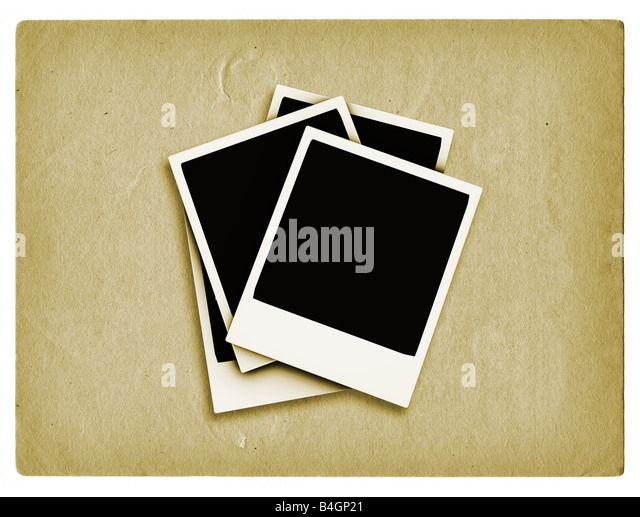 Polaroids on grunge style background - Stock Image