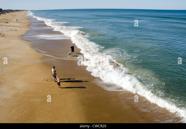 Family Swimming at Kitty Hawk Beach on the Outer Banks of North Carolina - Stock Image