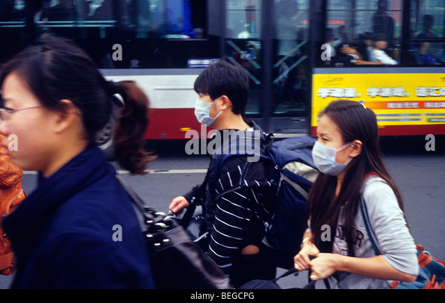 Young couple wear masks to protect against severe air pollution in Beijing, China. 30-Sep-2009 - Stock Image
