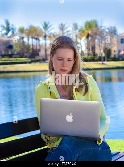 Teenage girl using mobile device outdoors  MR  © Myrleen Pearson - Stock-Bilder