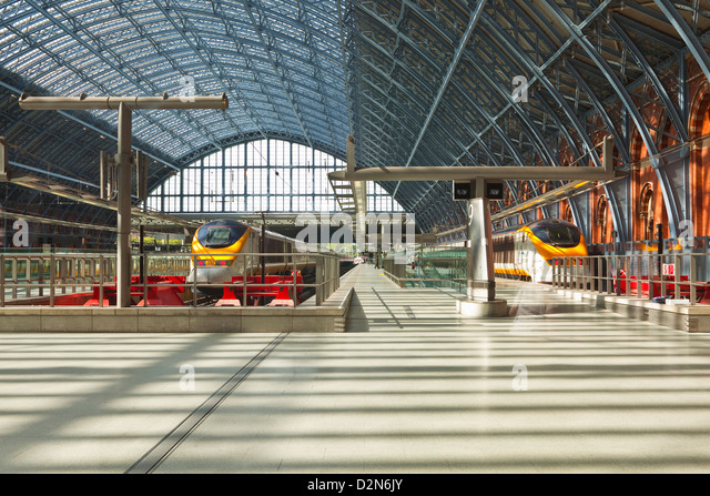 Two Eurostar trains await departure at St. Pancras International, London, England, United Kingdom, Europe - Stock Image