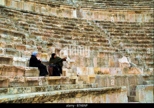 Woman in Roman theatre Amman Jordan - Stock Image