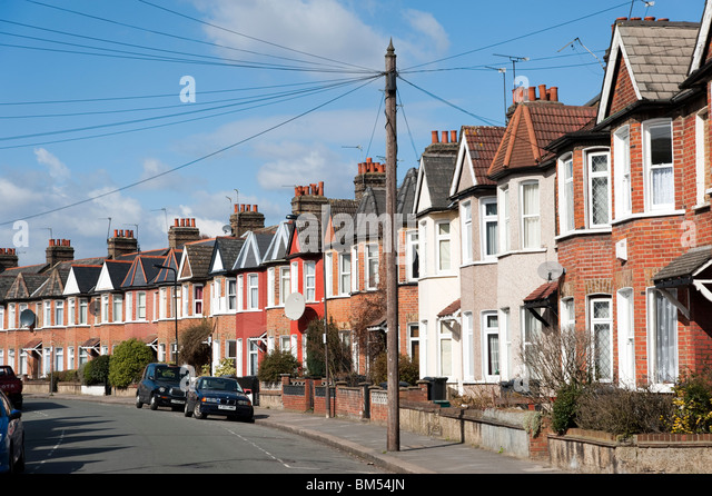 Row of terraced houses in residential Street, London, England, UK - Stock Image