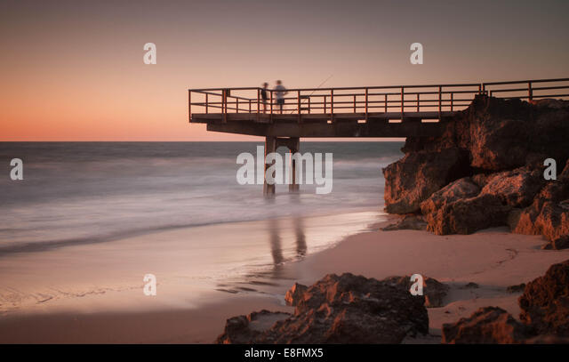 Fishermen standing on jetty, North Beach, Perth, Australia - Stock Image