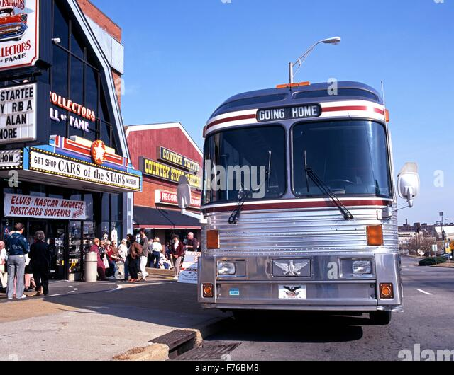 Tour bus parked outside shops and businesses along Music Row, Nashville, Tennessee, United States of America. - Stock Image