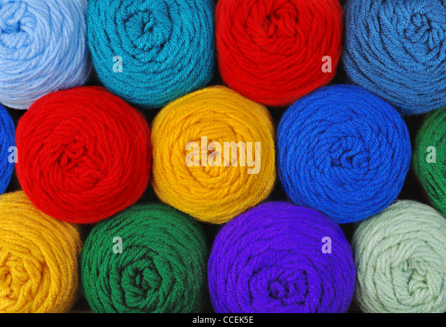 skeins of acrylic yarn in several colors - Stock Image