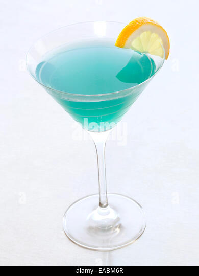 Blue Martini with slice of lemon - Stock Image