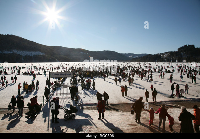 Crowds on the frozen Titisee lake in the Black Forest, Baden-Wuerttemberg, Germany, Europe - Stock Image