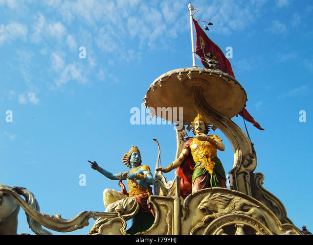 Lord Krishna preaching Bhagavadgita to Arjuna at battlefield in Kurukshetra - Stock Image