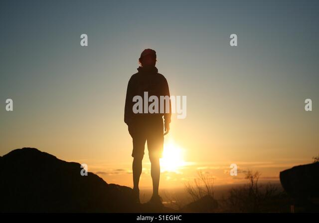 This is a picture my friend took of me as the sun set from up in the mountains above Boise, Idaho. - Stock Image