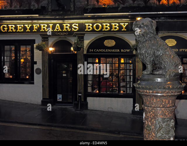 Greyfriars Bobby historic pub at dusk, Edinburgh Old Town, Dog outside, Lothians, Scotland, UK - With Bobby - Stock Image