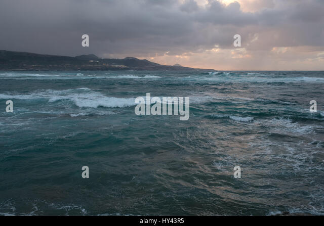 Scenic View Of Sea Against Dramatic Sky - Stock Image