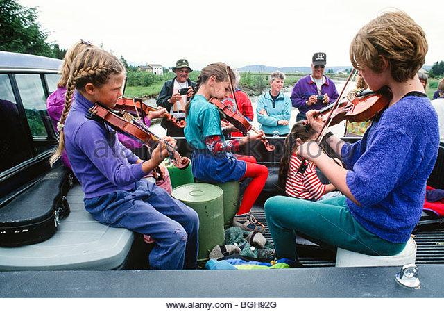 Alaska. Gustavus. 4th of July Fiddlers. - Stock Image