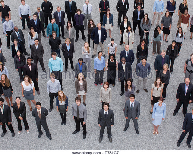 Portrait of business people in crowd - Stock Image