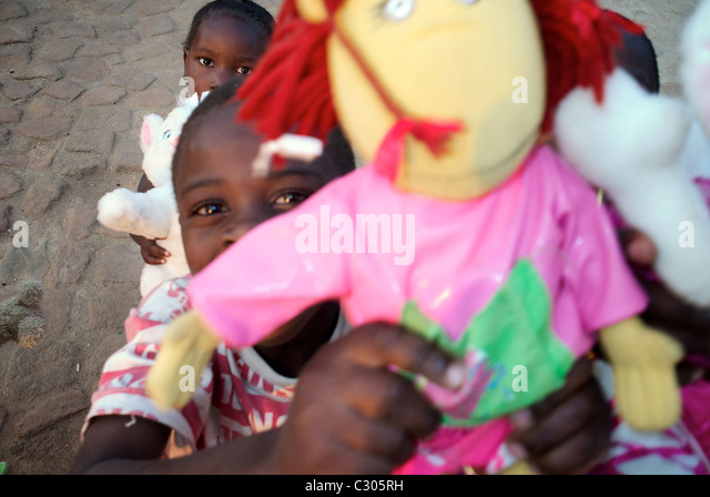 African orphans with toys . Mahenge Tanzania. - Stock Image