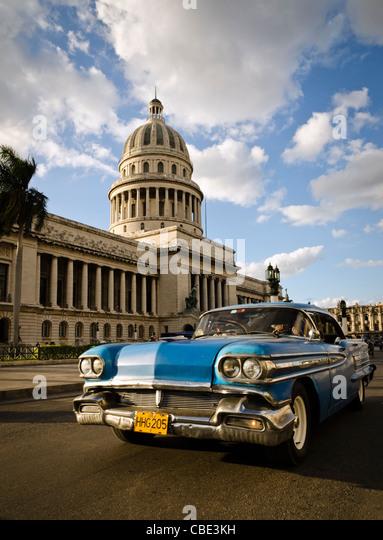 Classic American car in front of El Capitolio Havana Cuba - Stock Image