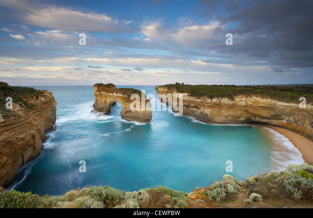 window arch at Loch Ard Gorge at dawn, Port Campbell National Park, Great Ocean Road, Victoria, Australia - Stock Image