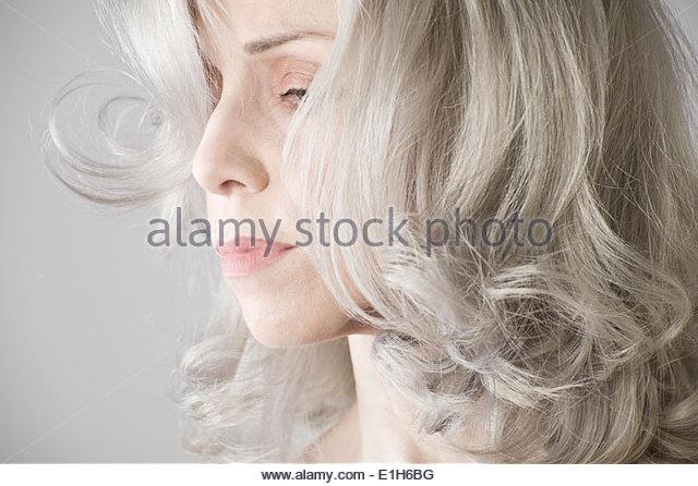 Cropped studio portrait of sad mature woman - Stock Image