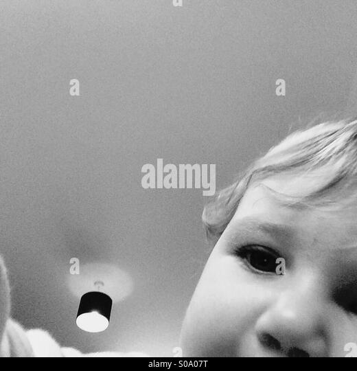 Photobomb baby - Stock Image