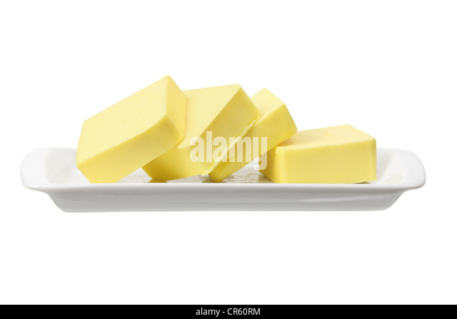 Slices of Butter on Plate - Stock Image