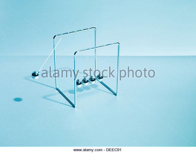 NewtonÂ's cradle swinging - Stock Image