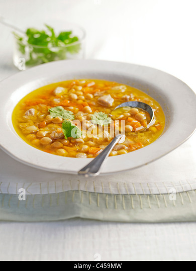 Chickpea and chicken soup in bowl, close-up - Stock Image