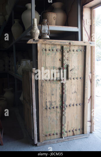 Traditional wooden door at the A'ali Pottery, Bahrain - Stock Image