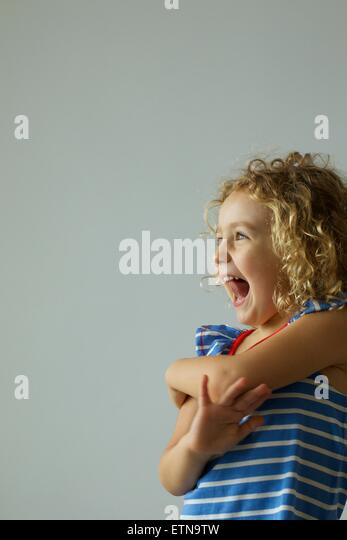 Portrait of a happy girl laughing - Stock Image