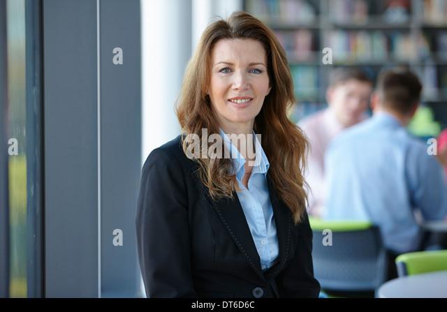 Portrait of mature businesswoman with long hair - Stock-Bilder