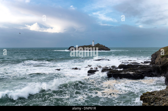 Godrevy Island and its lighthouse off the coast at St Ives in Cornwall - Stock Image