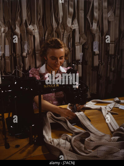 Woman stitching parachute harnesses during World War II, 1942. - Stock Image