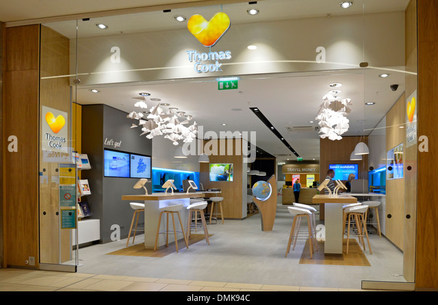 Thomas Cook travel agents premises at indoor shopping mall with new 'Sunny Heart' corporate logo rebranding - Stock-Bilder