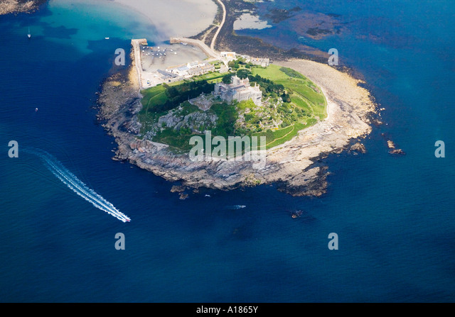 St Michael's Michaels Mount from the air with speed boat in the sea aerial view Cornwall England UK United Kingdom - Stock Image