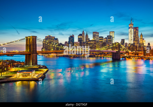Famous view of New York City over the East River towards the financial district in the borough of Manhattan. - Stock Image
