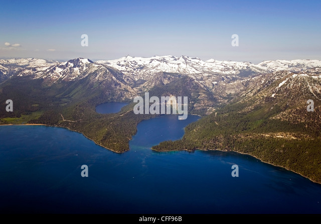 An aerial photograph of Lake Tahoe and Emerald Bay in the summer with Desolation Wilderness still covered in snow, - Stock Image